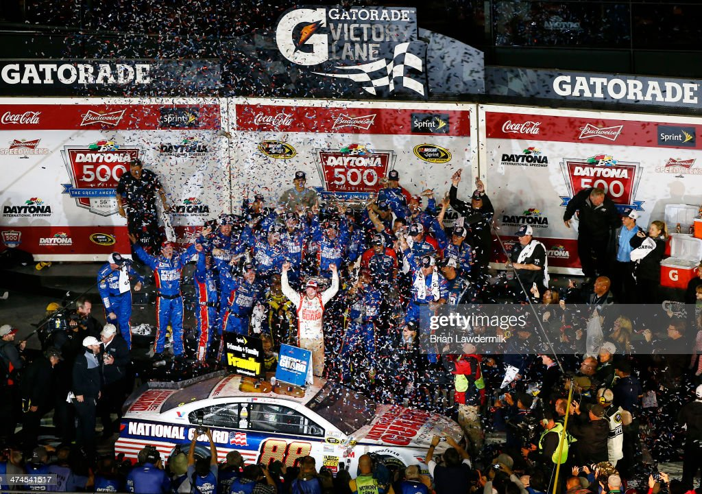 Dale Earnhardt Jr., driver of the #88 National Guard Chevrolet, celebrates in Victory Lane after winning during the NASCAR Sprint Cup Series Daytona 500 at Daytona International Speedway on February 23, 2014 in Daytona Beach, Florida.