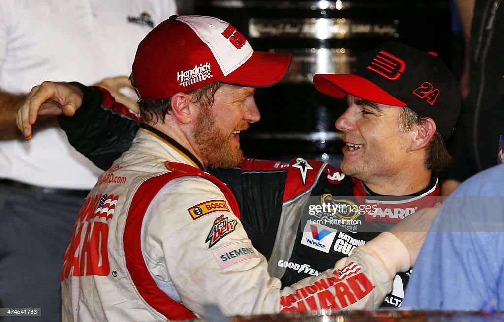 Dale Earnhardt Jr., driver of the #88 National Guard Chevrolet (left), celebrates with Jeff Gordon, driver of the #24 Drive To End Hunger Chevrolet, in victory lane after winning during the NASCAR Sprint Cup Series Daytona 500 at Daytona International Speedway on February 23, 2014 in Daytona Beach, Florida.