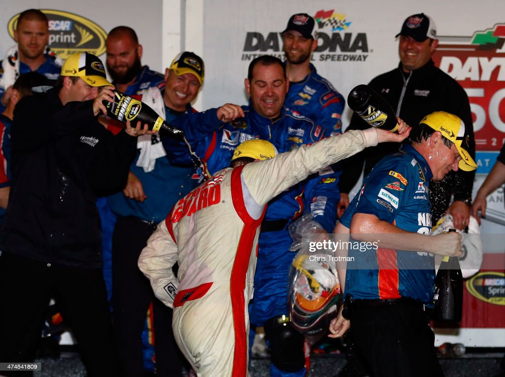 Dale Earnhardt Jr., driver of the #88 National Guard Chevrolet, celebrates in Victory Lane with crew chief Steve Letarte after winning the NASCAR Sprint Cup Series Daytona 500 at Daytona International Speedway on February 23, 2014 in Daytona Beach, Florida.