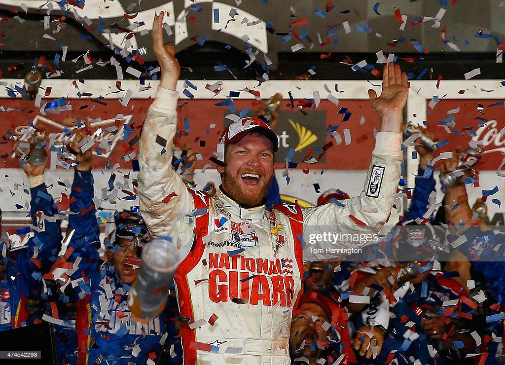 <a gi-track='captionPersonalityLinkClicked' href=/galleries/search?phrase=Dale+Earnhardt+Jr.&family=editorial&specificpeople=171293 ng-click='$event.stopPropagation()'>Dale Earnhardt Jr.</a>, driver of the #88 National Guard Chevrolet, celebrates in Victory Lane after winning during the NASCAR Sprint Cup Series Daytona 500 at Daytona International Speedway on February 23, 2014 in Daytona Beach, Florida.
