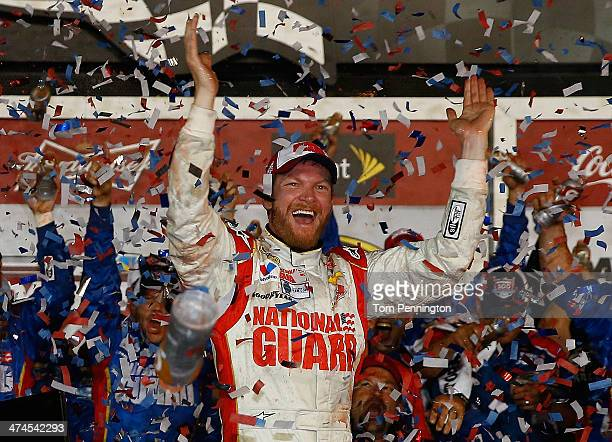 Dale Earnhardt Jr driver of the National Guard Chevrolet celebrates in Victory Lane after winning during the NASCAR Sprint Cup Series Daytona 500 at...