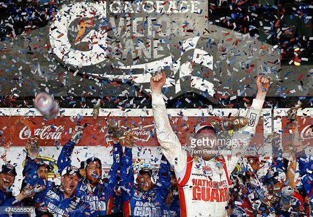 Dale Earnhardt Jr driver of the National Guard Chevrolet celebrates in Victory Lane after winning the NASCAR Sprint Cup Series Daytona 500 at Daytona...