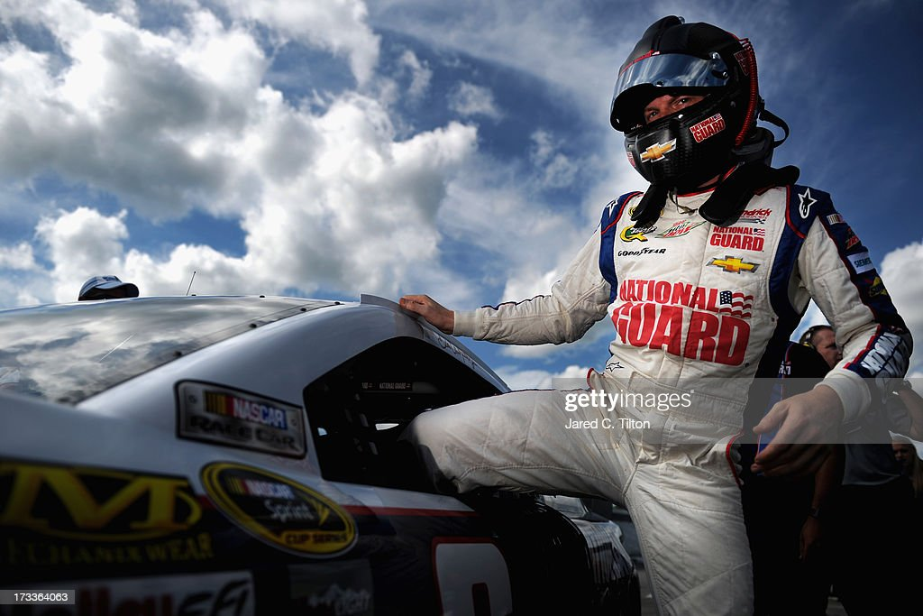 <a gi-track='captionPersonalityLinkClicked' href=/galleries/search?phrase=Dale+Earnhardt+Jr.&family=editorial&specificpeople=171293 ng-click='$event.stopPropagation()'>Dale Earnhardt Jr.</a>, driver of the #88 National Guard Chevrolet, climbs out of his car after qualifying for the NASCAR Sprint Cup Series Camping World RV Sales 301 at New Hampshire Motor Speedway on July 12, 2013 in Loudon, New Hampshire.