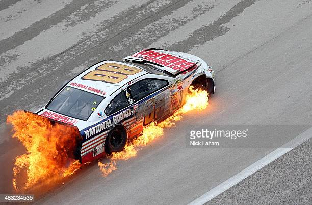 Dale Earnhardt Jr driver of the National Guard Chevrolet crashes early in the NASCAR Sprint Cup Series Duck Commander 500 at Texas Motor Speedway on...