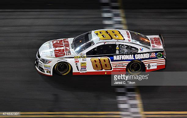 Dale Earnhardt Jr driver of the National Guard Chevrolet crosses the finishline to win the NASCAR Sprint Cup Series Daytona 500 at Daytona...