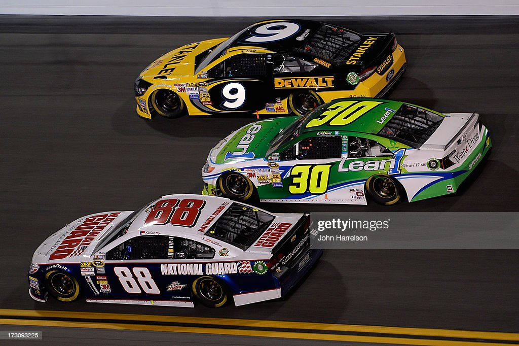 Dale Earnhardt Jr., driver of the #88 National Guard Chevrolet, David Stremme, driver of the #30 Lean 1 Toyota, and Marcos Ambrose, driver of the #9 Stanley Ford, race during the NASCAR Sprint Cup Series Coke Zero 400 at Daytona International Speedway on July 6, 2013 in Daytona Beach, Florida.