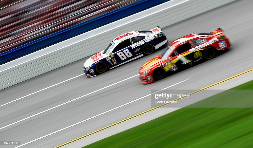 Dale Earnhardt Jr., driver of the #88 National Guard Chevrolet, drives side by each with Jamie McMurray, driver of the #1 McDonald's Chevrolet, during practice for the NASCAR Sprint Cup Series Aaron's 499 at Talladega Superspeedway on May 3, 2013 in Talladega, Alabama.