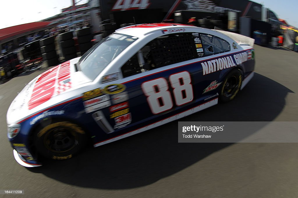 Dale Earnhardt Jr., driver of the #88 National Guard Chevrolet, drives to the garage area during practice for the NASCAR Sprint Cup Series Auto Club 400 at Auto Club Speedway on March 23, 2013 in Fontana, California.