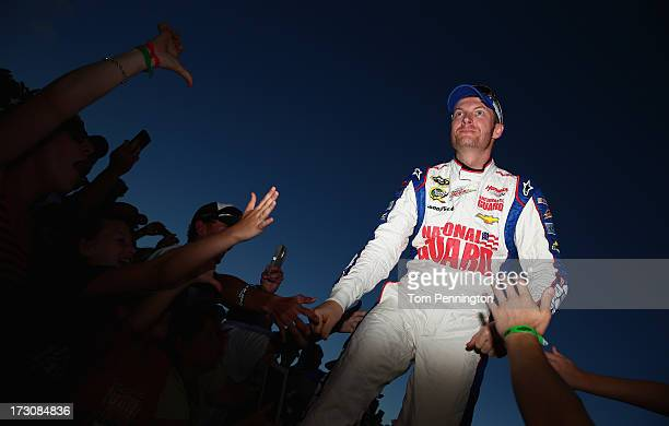 Dale Earnhardt Jr driver of the National Guard Chevrolet greets fans during driver introductions during the NASCAR Sprint Cup Series Coke Zero 400 at...