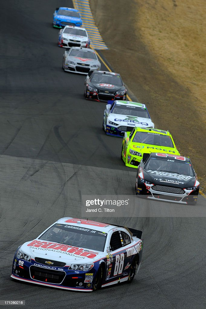 Dale Earnhardt Jr., driver of the #88 National Guard Chevrolet, leads Boris Said, driver of the #32 Hendrickcars.com Ford, during the NASCAR Sprint Cup Series Toyota/Save Mart 350 at Sonoma Raceway on June 23, 2013 in Sonoma, California.