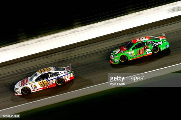 Dale Earnhardt Jr driver of the National Guard Chevrolet leads Danica Patrick driver of the GoDaddy Chevrolet during the NASCAR Sprint Cup Series...