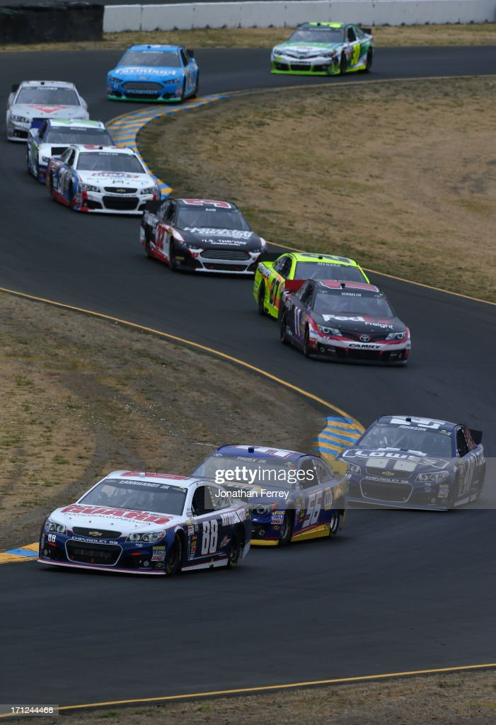 Dale Earnhardt Jr., driver of the #88 National Guard Chevrolet, leads Martin Truex Jr., driver of the #56 NAPA Auto Parts Toyota, during the NASCAR Sprint Cup Series Toyota/Save Mart 350 at Sonoma Raceway on June 23, 2013 in Sonoma, California.