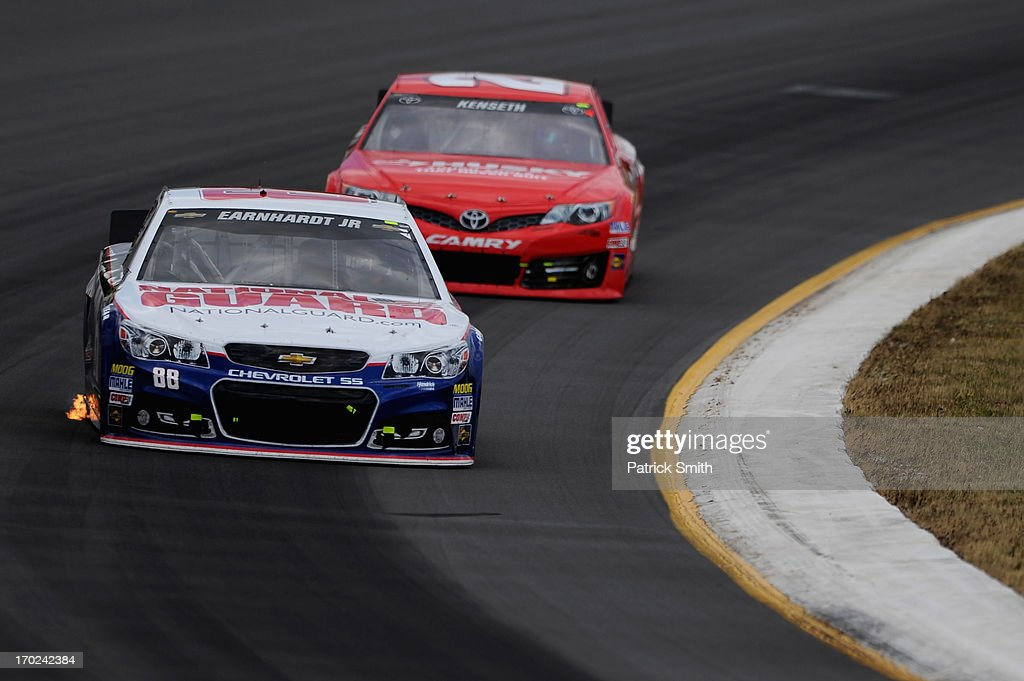 <a gi-track='captionPersonalityLinkClicked' href=/galleries/search?phrase=Dale+Earnhardt+Jr.&family=editorial&specificpeople=171293 ng-click='$event.stopPropagation()'>Dale Earnhardt Jr.</a>, driver of the #88 National Guard Chevrolet, leads <a gi-track='captionPersonalityLinkClicked' href=/galleries/search?phrase=Matt+Kenseth&family=editorial&specificpeople=204192 ng-click='$event.stopPropagation()'>Matt Kenseth</a>, driver of the #20 The Home Depot/Husky Toyota, during the NASCAR Sprint Cup Series Party in the Poconos 400 at Pocono Raceway on June 9, 2013 in Long Pond, Pennsylvania.