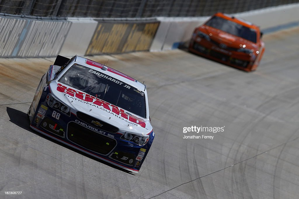 Dale Earnhardt Jr., driver of the #88 National Guard Chevrolet, leads Matt Kenseth, driver of the #20 Home Depot 'Let's Do This' Toyota, during the NASCAR Sprint Cup Series AAA 400 at Dover International Speedway on September 29, 2013 in Dover, Delaware.