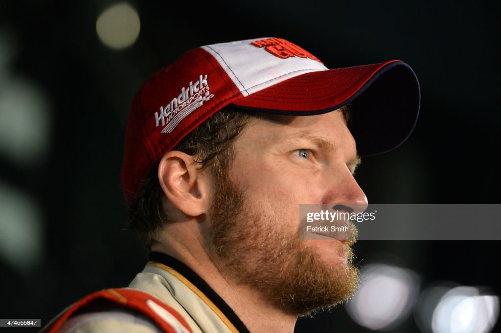 Dale Earnhardt Jr., driver of the #88 National Guard Chevrolet, looks on in Victory Lane after winning the NASCAR Sprint Cup Series Daytona 500 at Daytona International Speedway on February 23, 2014 in Daytona Beach, Florida.
