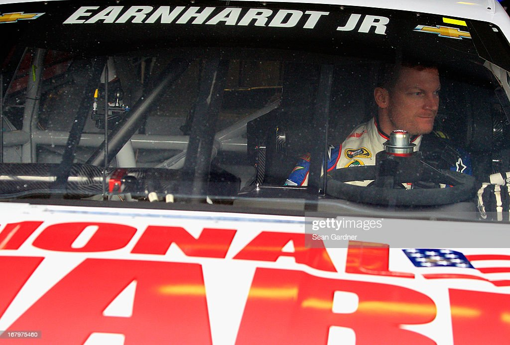 Dale Earnhardt Jr., driver of the #88 National Guard Chevrolet, looks on from his car during practice for the NASCAR Sprint Cup Series Aaron's 499 at Talladega Superspeedway on May 3, 2013 in Talladega, Alabama.