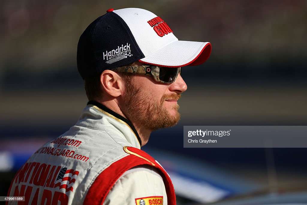 Dale Earnhardt Jr., driver of the #88 National Guard Chevrolet, looks on during qualifying for the NASCAR Sprint Cup Series Auto Club 400 at Auto Club Speedway on March 21, 2014 in Fontana, California.