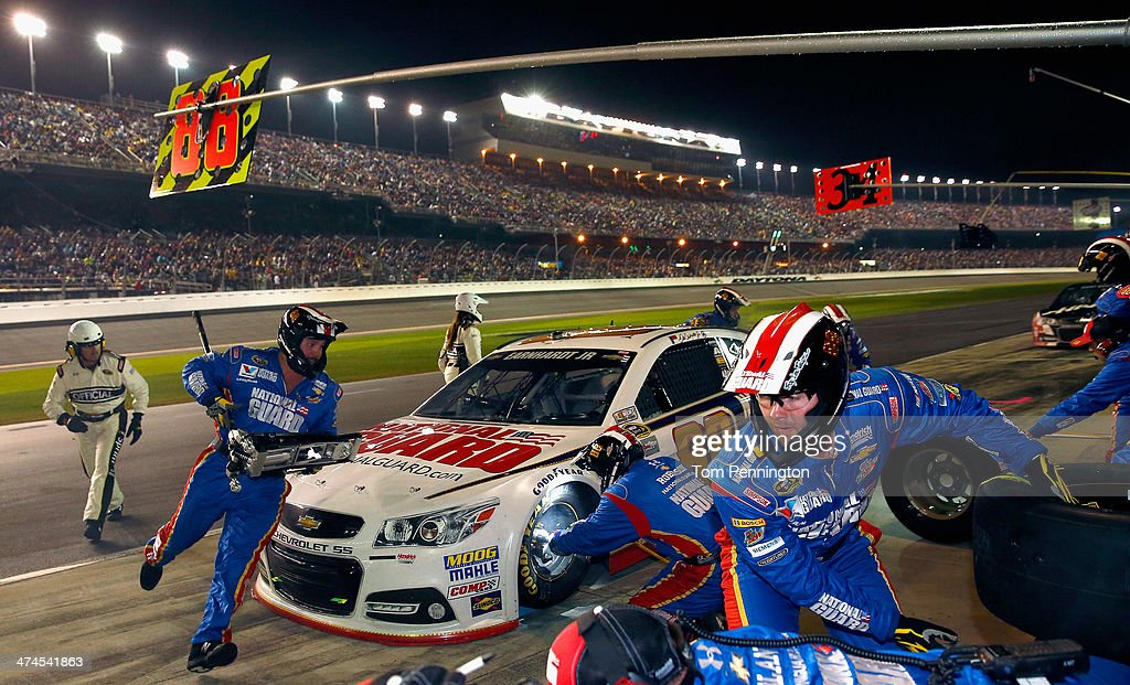 <a gi-track='captionPersonalityLinkClicked' href=/galleries/search?phrase=Dale+Earnhardt+Jr.&family=editorial&specificpeople=171293 ng-click='$event.stopPropagation()'>Dale Earnhardt Jr.</a>, driver of the #88 National Guard Chevrolet, pits during the NASCAR Sprint Cup Series Daytona 500 at Daytona International Speedway on February 23, 2014 in Daytona Beach, Florida.