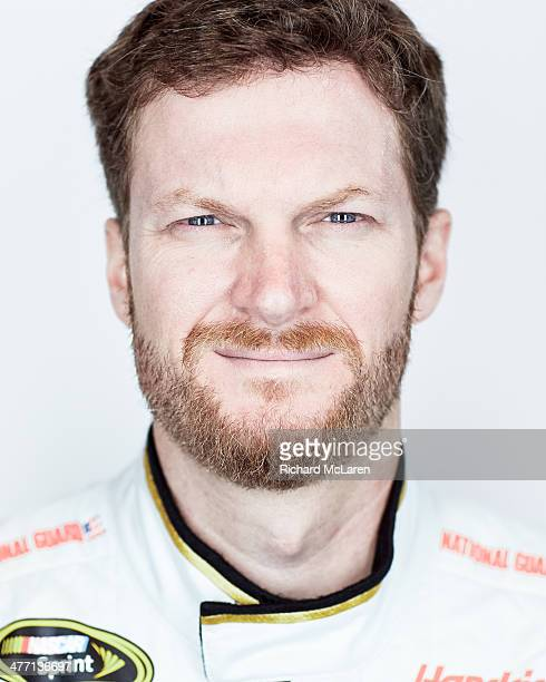 Dale Earnhardt Jr driver of the National Guard Chevrolet poses for a portrait during the 2014 NASCAR Media Day at Daytona International Speedway on...