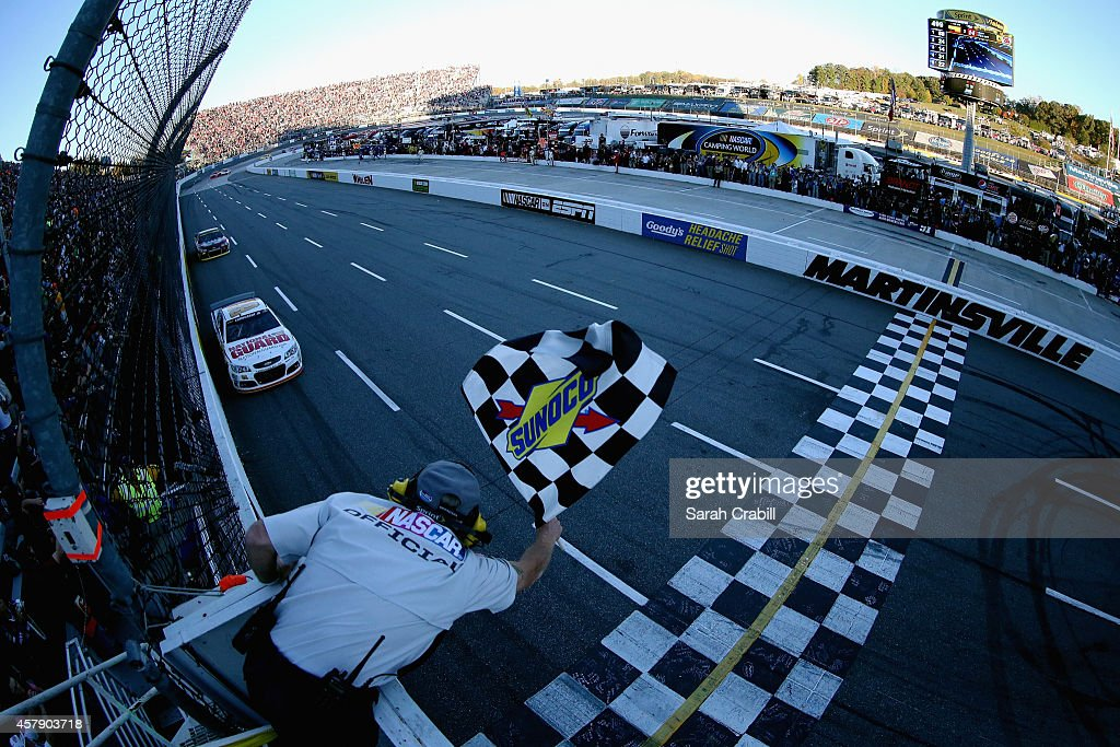 Dale Earnhardt Jr driver of the National Guard Chevrolet races to the checkered flag to win the NASCAR Sprint Cup Series Goody's Headache Relief Shot...