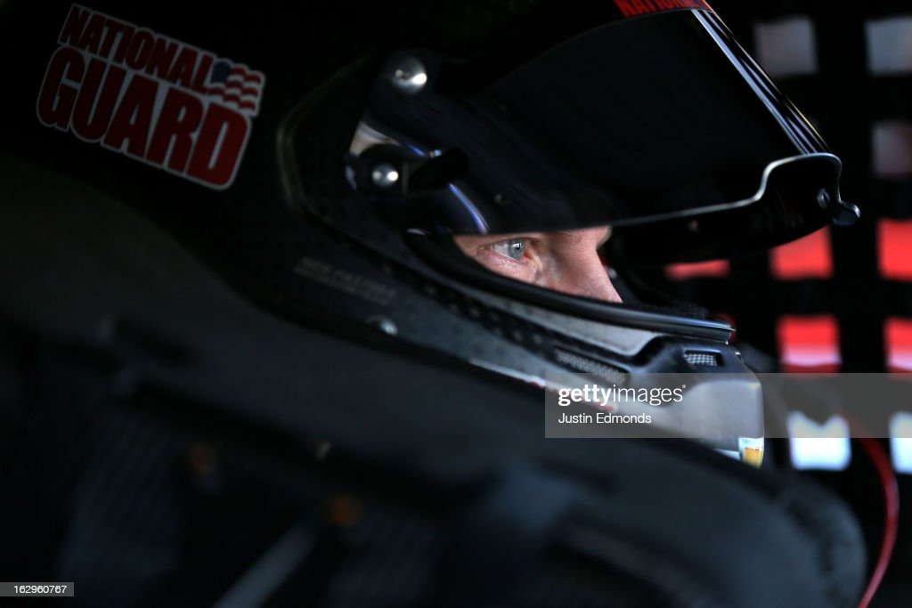 <a gi-track='captionPersonalityLinkClicked' href=/galleries/search?phrase=Dale+Earnhardt+Jr.&family=editorial&specificpeople=171293 ng-click='$event.stopPropagation()'>Dale Earnhardt Jr.</a>, driver of the #88 National Guard Chevrolet, sits in his car in the garage during practice for the NASCAR Sprint Cup Series Fresh Fit 500 at Phoenix International Raceway on March 2, 2013 in Avondale, Arizona.