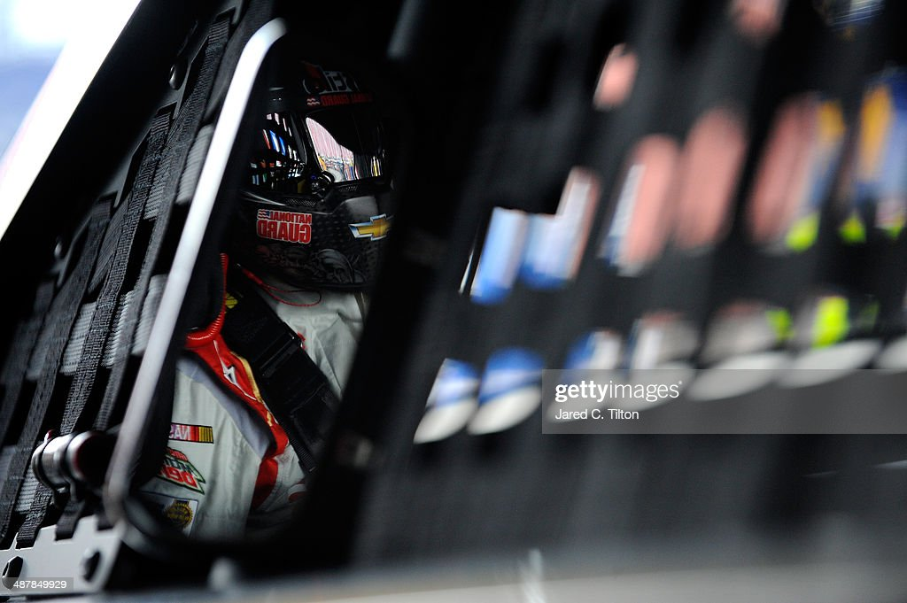 Dale Earnhardt Jr., driver of the #88 National Guard Chevrolet, sits in his car in the garage during practice for the NASCAR Sprint Cup Series Aaron's 499 at Talladega Superspeedway on May 2, 2014 in Talladega, Alabama.