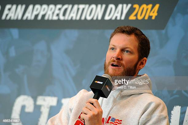 Dale Earnhardt Jr driver of the National Guard Chevrolet speaks on stage during NASCAR Hall of Fame Fan Appreciation Day at NASCAR Hall of Fame on...