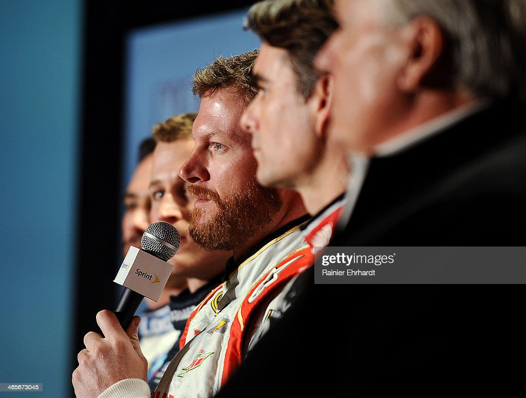 Dale Earnhardt Jr., driver of the #88 National Guard Chevrolet (center), speaks during the NASCAR Sprint Media Tour at Charlotte Convention Center on January 28, 2014 in Charlotte, North Carolina.