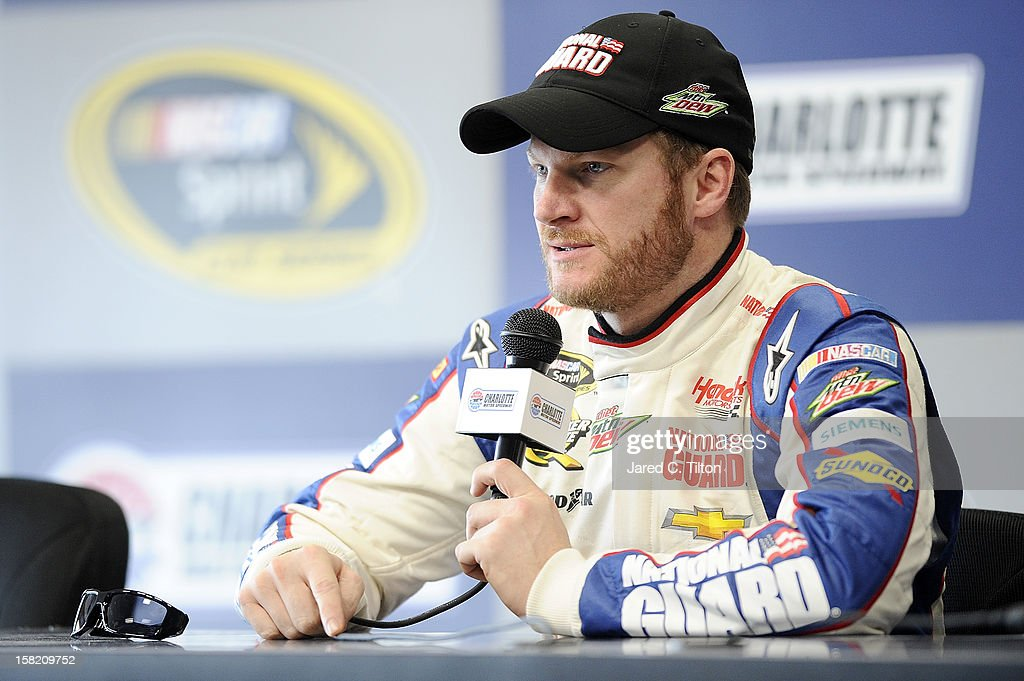 Dale Earnhardt Jr., driver of the #88 National Guard Chevrolet, speaks with the media during testing at Charlotte Motor Speedway on December 11, 2012 in Concord, North Carolina.