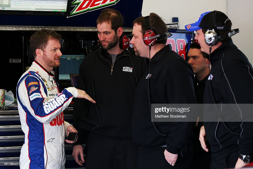 Dale Earnhardt Jr., driver of the #88 National Guard Chevrolet, speaks with the crew during practice for the NASCAR Sprint Cup Series Daytona 500 at Daytona International Speedway on February 16, 2013 in Daytona Beach, Florida