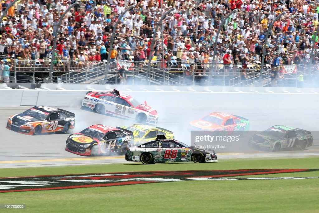 <a gi-track='captionPersonalityLinkClicked' href=/galleries/search?phrase=Dale+Earnhardt+Jr.&family=editorial&specificpeople=171293 ng-click='$event.stopPropagation()'>Dale Earnhardt Jr.</a>, driver of the #88 National Guard Chevrolet, spins on the front stretech during the NASCAR Sprint Cup Series Coke Zero 400 at Daytona International Speedway on July 6, 2014 in Daytona Beach, Florida.