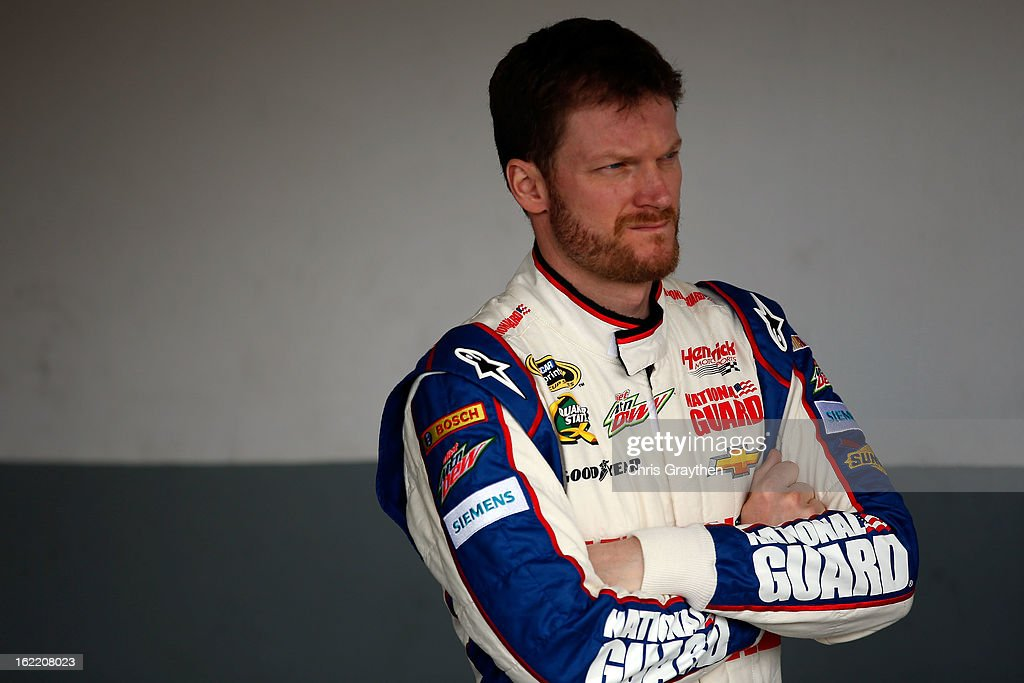 Dale Earnhardt Jr., driver of the #88 National Guard Chevrolet, stands in the garage during practice for the NASCAR Sprint Cup Series Daytona 500 at Daytona International Speedway on February 20, 2013 in Daytona Beach, Florida.
