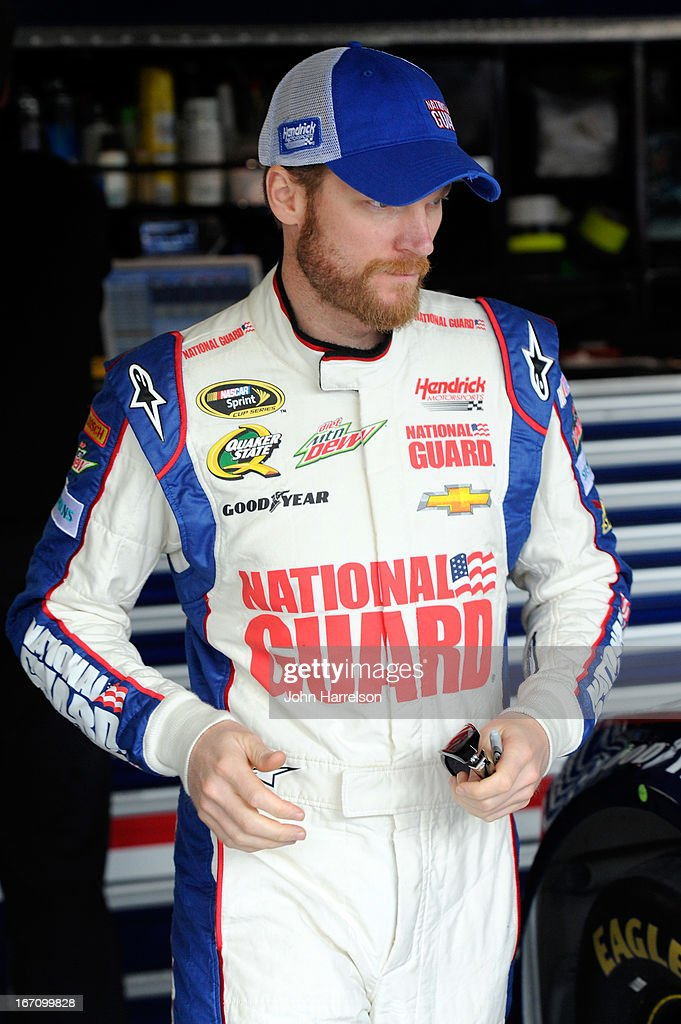 Dale Earnhardt Jr., driver of the #88 National Guard Chevrolet, stands in the garage during practice for the NASCAR Sprint Cup Series STP 400 at Kansas Speedway on April 20, 2013 in Kansas City, Kansas.