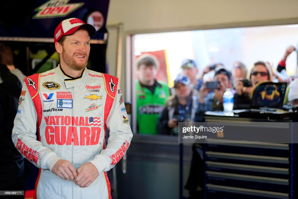 <a gi-track='captionPersonalityLinkClicked' href=/galleries/search?phrase=Dale+Earnhardt+Jr.&family=editorial&specificpeople=171293 ng-click='$event.stopPropagation()'>Dale Earnhardt Jr.</a>, driver of the #88 National Guard Chevrolet, stands in the garage area during practice for the NASCAR Sprint Cup Series Daytona 500 at Daytona International Speedway on February 15, 2014 in Daytona Beach, Florida.
