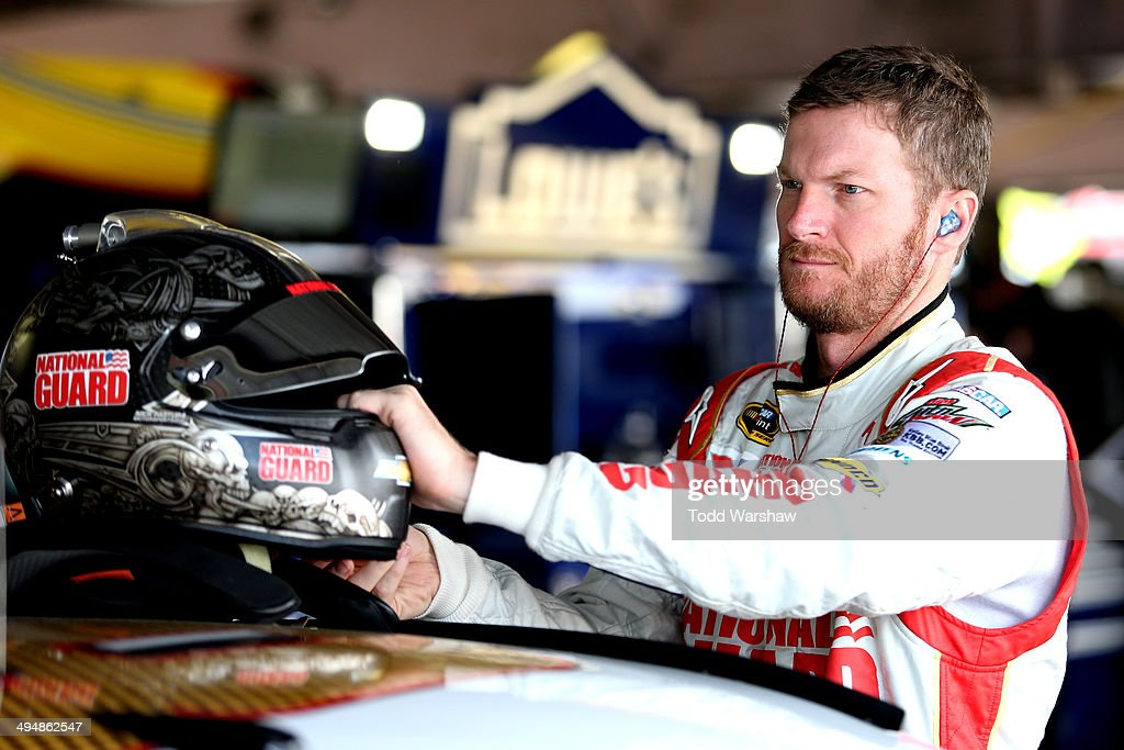 <a gi-track='captionPersonalityLinkClicked' href=/galleries/search?phrase=Dale+Earnhardt+Jr.&family=editorial&specificpeople=171293 ng-click='$event.stopPropagation()'>Dale Earnhardt Jr.</a>, driver of the #88 National Guard Chevrolet, stands in the garage area during practice for the NASCAR Sprint Cup Series FedEx 400 Benefiting Autism Speaks at Dover International Speedway on May 31, 2014 in Dover, Delaware.