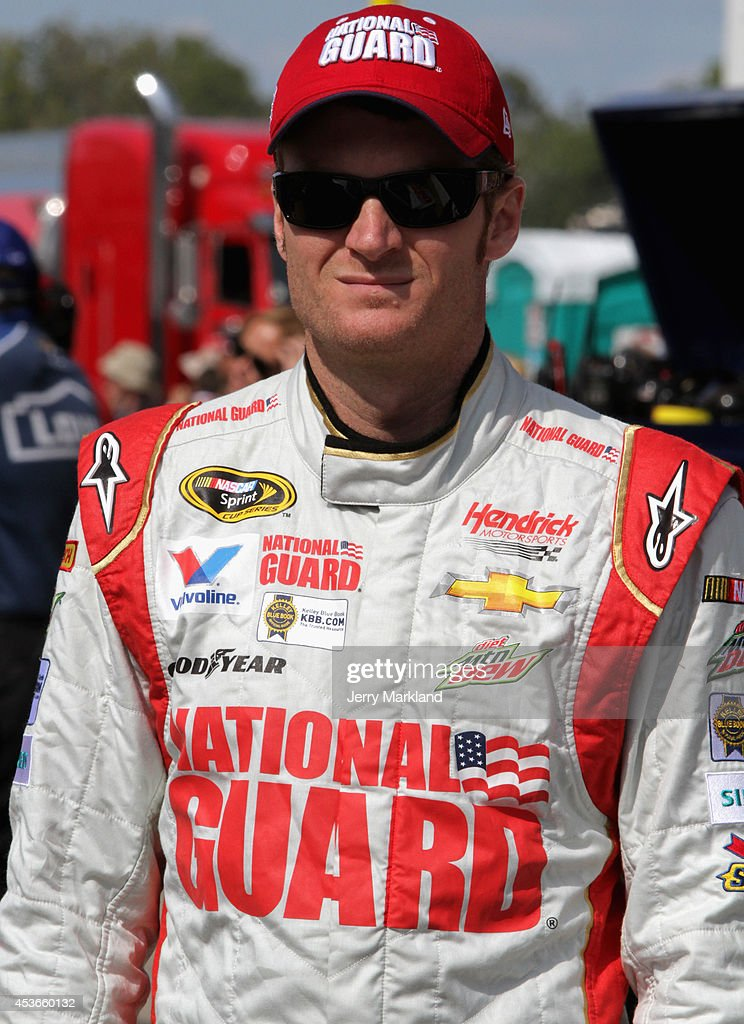 Dale Earnhardt Jr., driver of the #88 National Guard Chevrolet, stands on the grid during qualifying for the NASCAR Sprint Cup Series Pure Michigan 400 at Michigan International Speedway on August 15, 2014 in Brooklyn, Michigan.