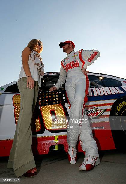 Dale Earnhardt Jr driver of the National Guard Chevrolet stands on the grid with his girlfriend Amy Reimann before the start of the NASCAR Sprint Cup...