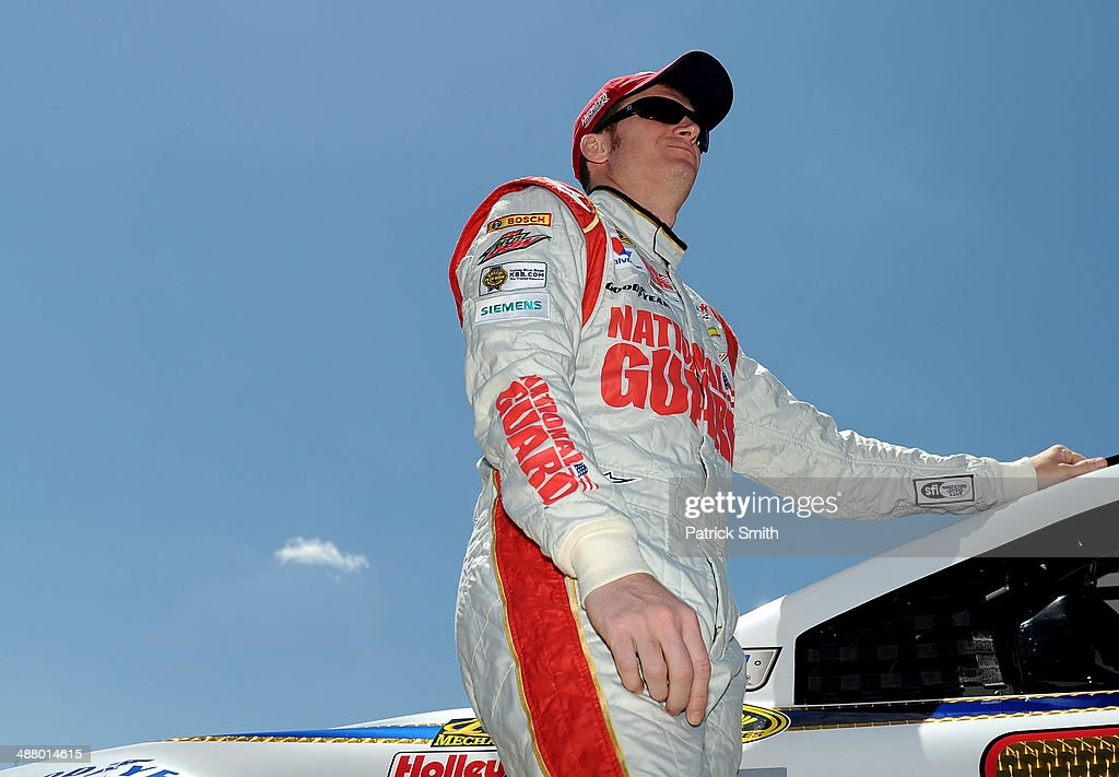 <a gi-track='captionPersonalityLinkClicked' href=/galleries/search?phrase=Dale+Earnhardt+Jr.&family=editorial&specificpeople=171293 ng-click='$event.stopPropagation()'>Dale Earnhardt Jr.</a>, driver of the #88 National Guard Chevrolet, stands on the grid during qualifying for the NASCAR Sprint Cup Series Aaron's 499 at Talladega Superspeedway on May 3, 2014 in Talladega, Alabama.