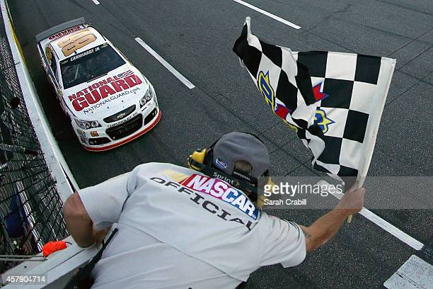 Dale Earnhardt Jr driver of the National Guard Chevrolet takes the checkered flag to win the NASCAR Sprint Cup Series Goody's Headache Relief Shot...