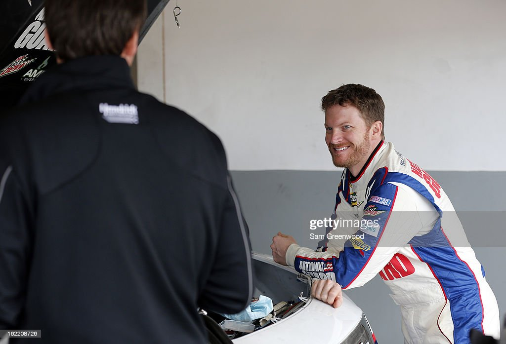 Dale Earnhardt Jr. (R), driver of the #88 National Guard Chevrolet, talks with chrew chief Steve Letarte (L) in the garage during practice for the NASCAR Sprint Cup Series Daytona 500 at Daytona International Speedway on February 20, 2013 in Daytona Beach, Florida.