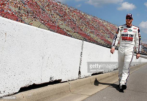 Dale Earnhardt Jr driver of the National Guard Drive the Guard / AMP Energy Chevrolet walks down pit road during the NASCAR Sprint Cup Series CARFAX...