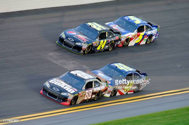 Dale Earnhardt Jr driver of the National Guard Heritage/Amp Energy Chevrolet Jeff Gordon driver of the Pepsi Max Chevrolet Jimmie Johnson driver of...