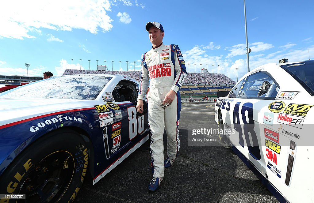 <a gi-track='captionPersonalityLinkClicked' href=/galleries/search?phrase=Dale+Earnhardt+Jr.&family=editorial&specificpeople=171293 ng-click='$event.stopPropagation()'>Dale Earnhardt Jr.</a>, driver of the #88 National Guard Youth Foundation Chevrolet, climbs out of his car during qualifying for the NASCAR Sprint Cup Series Quaker State 400 at Kentucky Speedway on June 28, 2013 in Sparta, Kentucky.