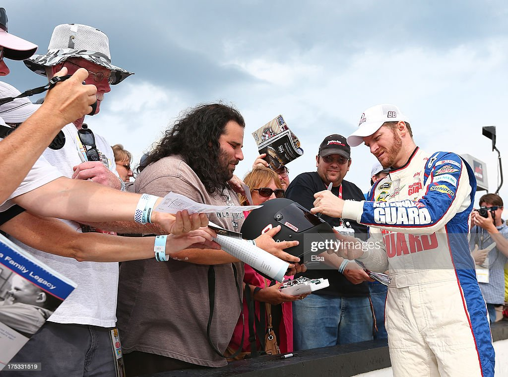 <a gi-track='captionPersonalityLinkClicked' href=/galleries/search?phrase=Dale+Earnhardt+Jr.&family=editorial&specificpeople=171293 ng-click='$event.stopPropagation()'>Dale Earnhardt Jr.</a>, driver of the #88 National Guard Youth Foundation Chevrolet, signs autographs before qualifying for the NASCAR Sprint Cup Series GoBowling.com 400 at Pocono Raceway on August 2, 2013 in Long Pond, Pennsylvania.