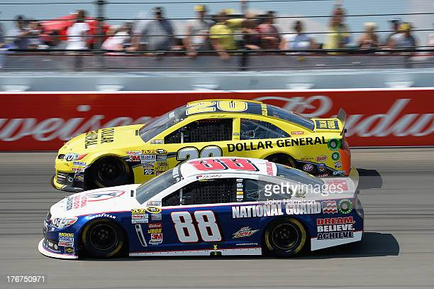 Dale Earnhardt Jr driver of the National Guard Youth Foundation Chevrolet races Matt Kenseth driver of the Dollar General Toyota during the NASCAR...