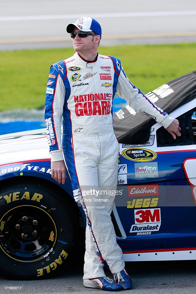 Dale Earnhardt Jr., driver of the #88 National Guard Youth Foundation Chevrolet, stands next to his car during qualifying for the NASCAR Sprint Cup Series Quaker State 400 at Kentucky Speedway on June 28, 2013 in Sparta, Kentucky.