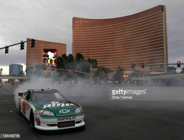 Dale Earnhardt Jr driver of the National Guard/Amp Energy Chevrolet does a burnout during the NASCAR Victory Lap in front of the Wynn Las Vegas on...