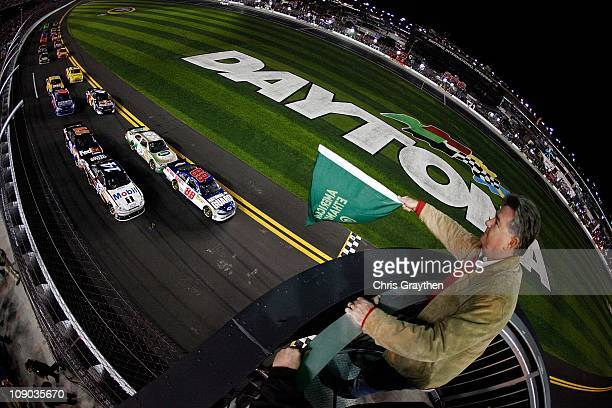 Dale Earnhardt Jr driver of the National Guard/AMP Energy Chevrolet leads the field at the start of the Budweiser Shootout at Daytona International...