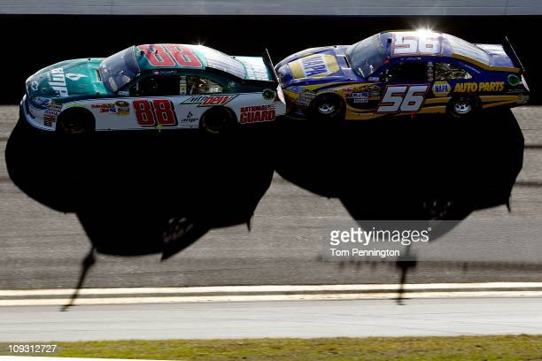 Dale Earnhardt Jr driver of the National Guard/AMP Energy Chevrolet and Martin Truex Jr driver of the NAPA Toyota race during the NASCAR Sprint Cup...