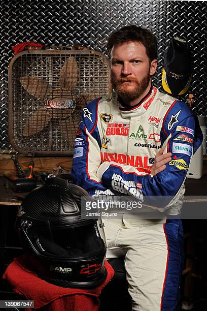 Dale Earnhardt Jr driver of the National Guard/Diet Mountain Dew Chevrolet poses during NASCAR Media Day at Daytona International Speedway on...